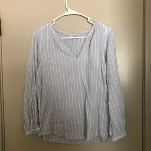 Light blue and white striped blouse.